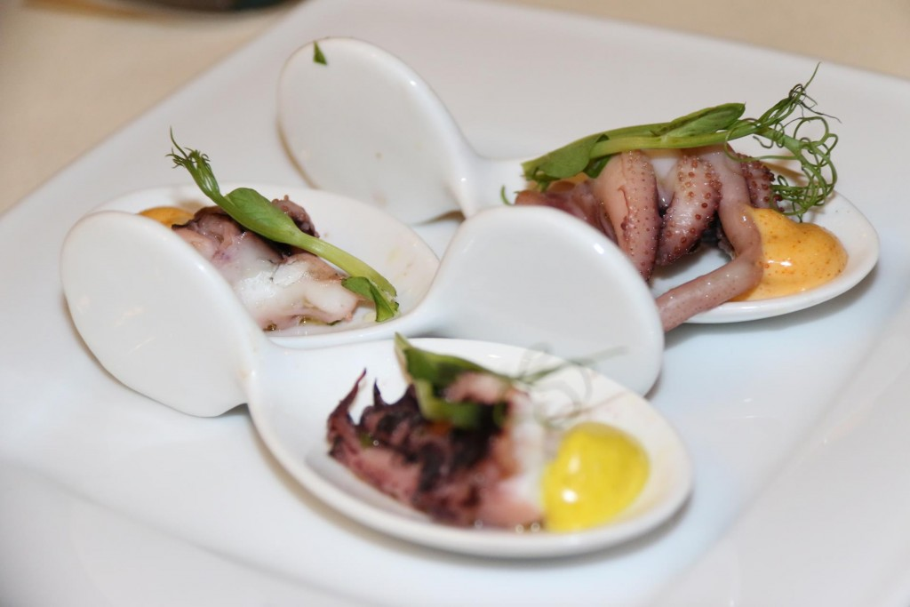 A small house appetiser of octopus arrives