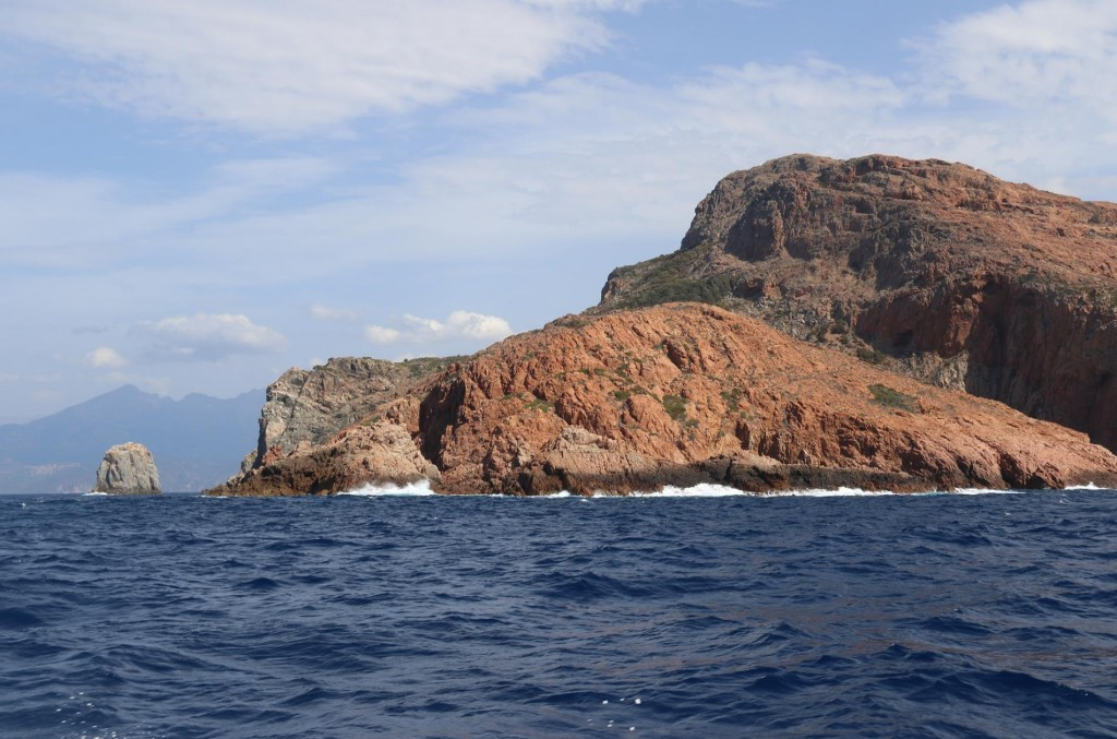 We look back to Cape Rossu and now we have the wind behind us which is ideal for travelling down the coast