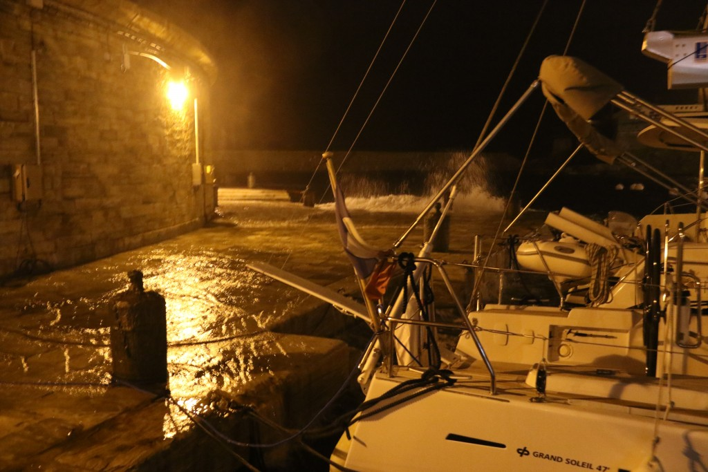 As was forecast for the evening and overnight, high winds brought a huge surge into the port which covered the quay with a river of water and made all the boats rock and roll