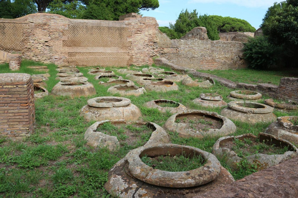35 large 26 litre terracotta jars set in the ground for storing solid and liquid foods such as oil and wine, were found in the Caseggiato dei Doli