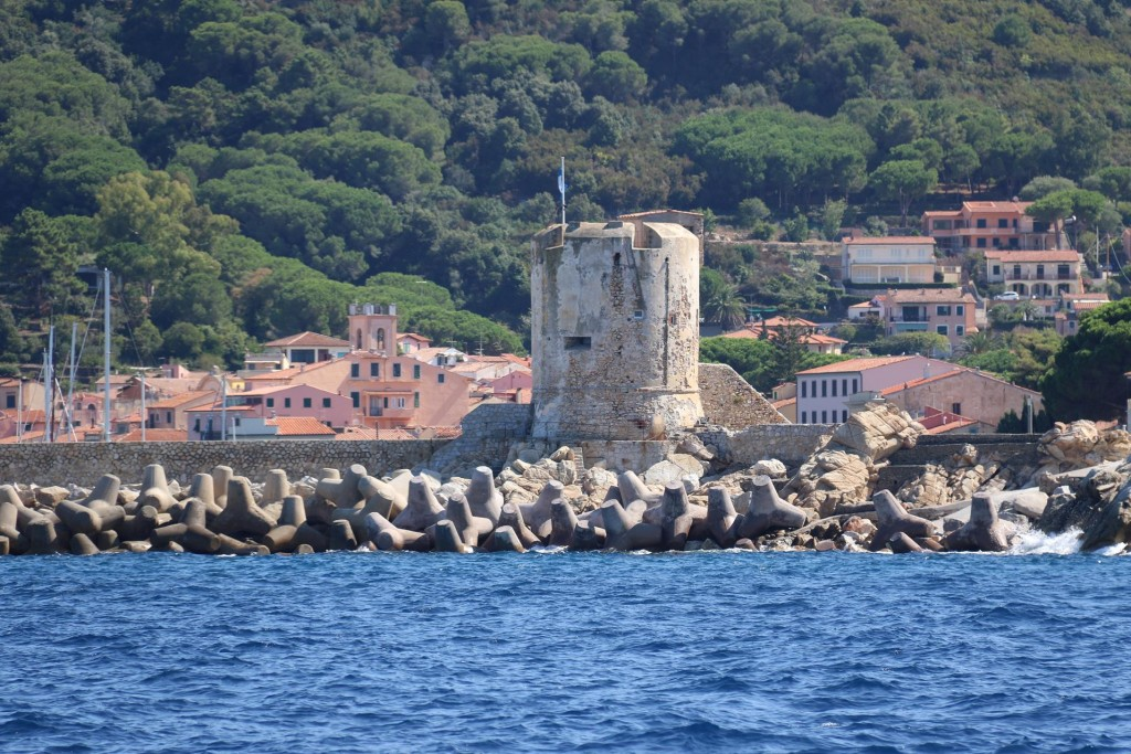 The ancient tower along the breakwater of the Marciana Marina