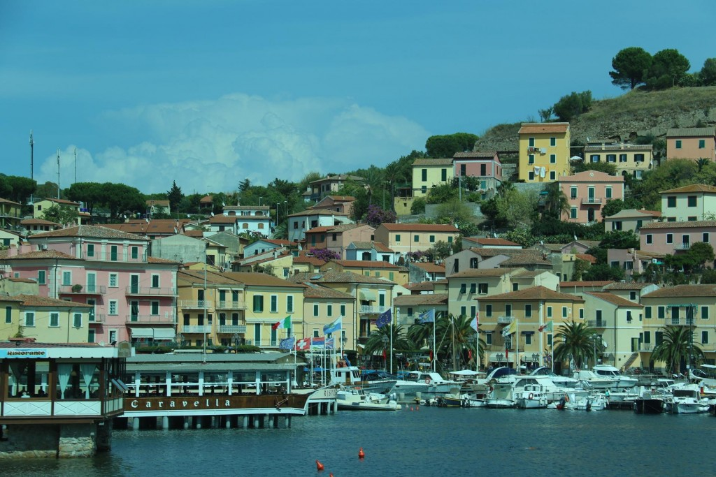 A couple of restaurants are built over the water in the main harbour of Porto Azzurro