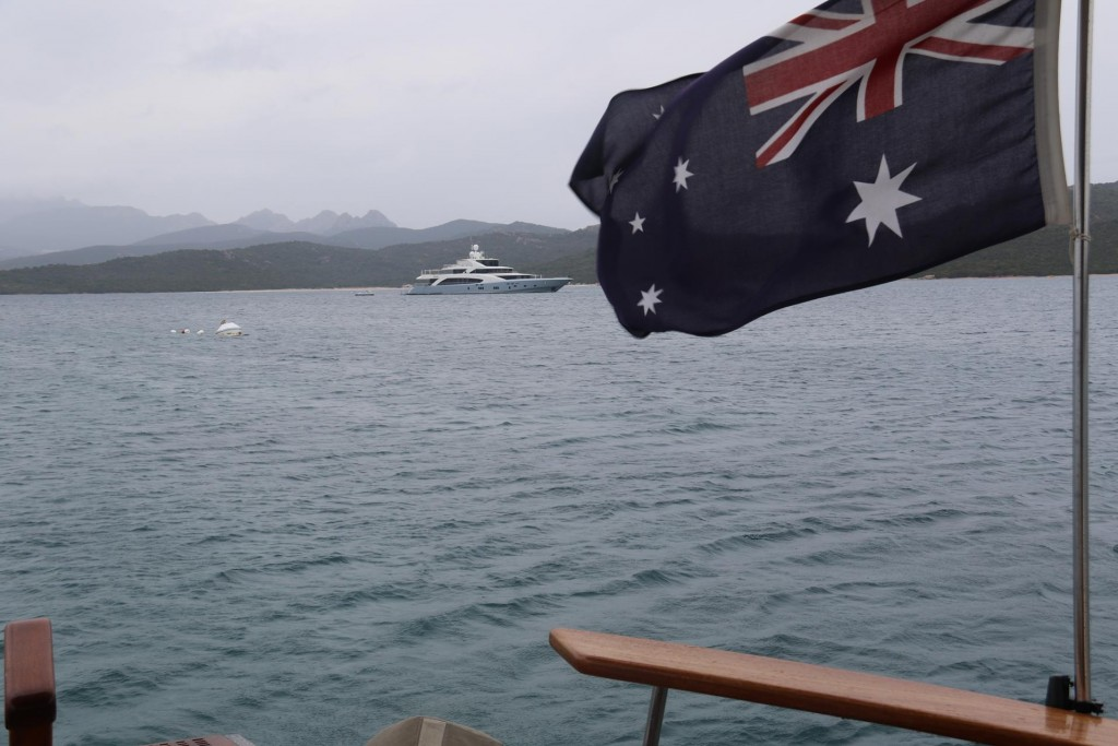 The superyacht is still on anchor as we depart the bay