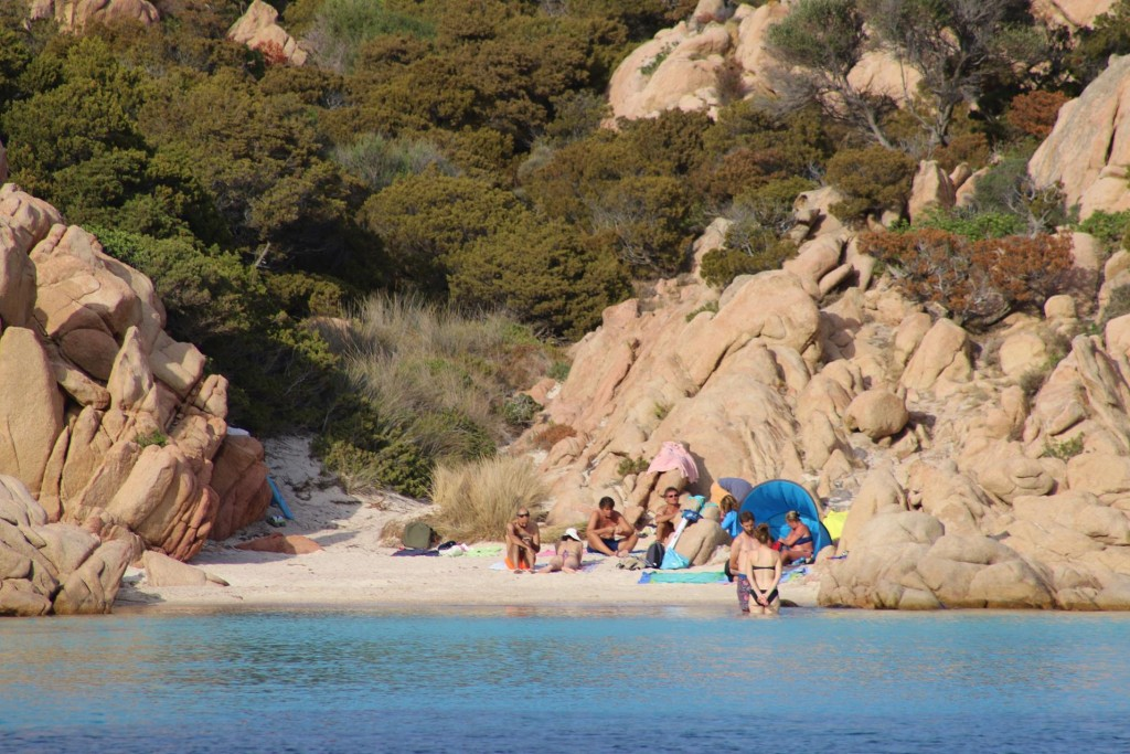 The other beach also has a few people enoying the sun and the turquoise water