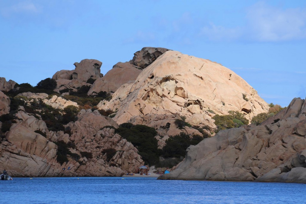 The sun seems to be shining on just one of the rocks in the cove