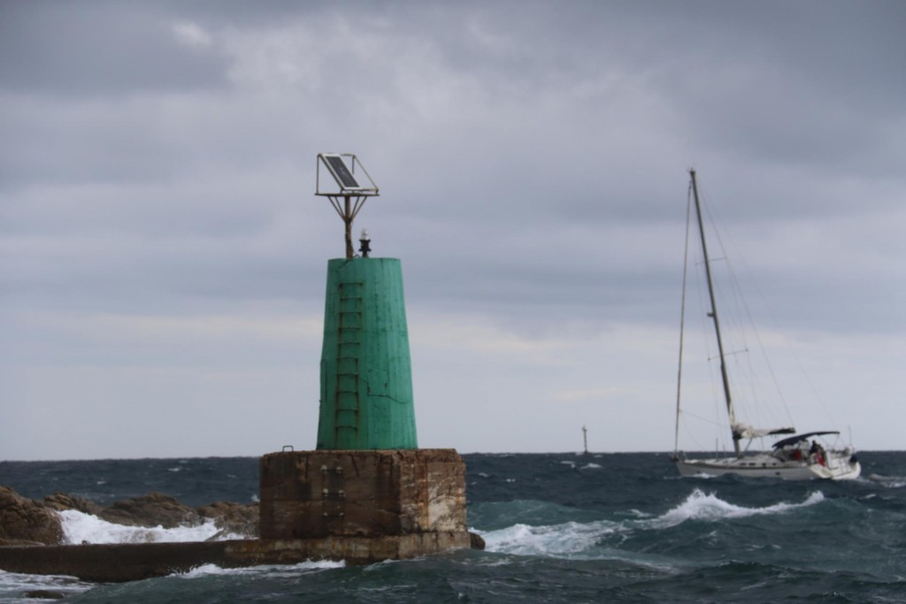 As we enter Porto Cervo a yacht leaves the port under quite rough conditions