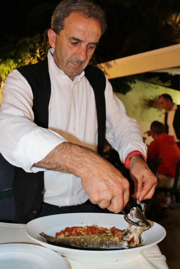 Mine host from Ristorante Pizzeria 'Zio Nicola' fillets my fish