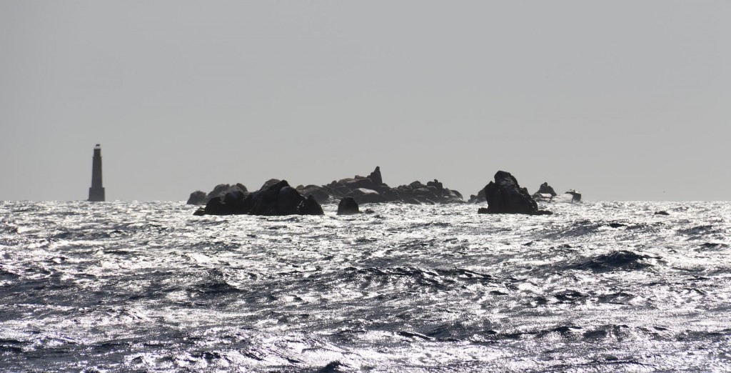 We carefully pass Les Moines which is a group of rocky islets a few miles off the shorerefully pass Les Moines which is a group of rocky islets a few miles off the shore