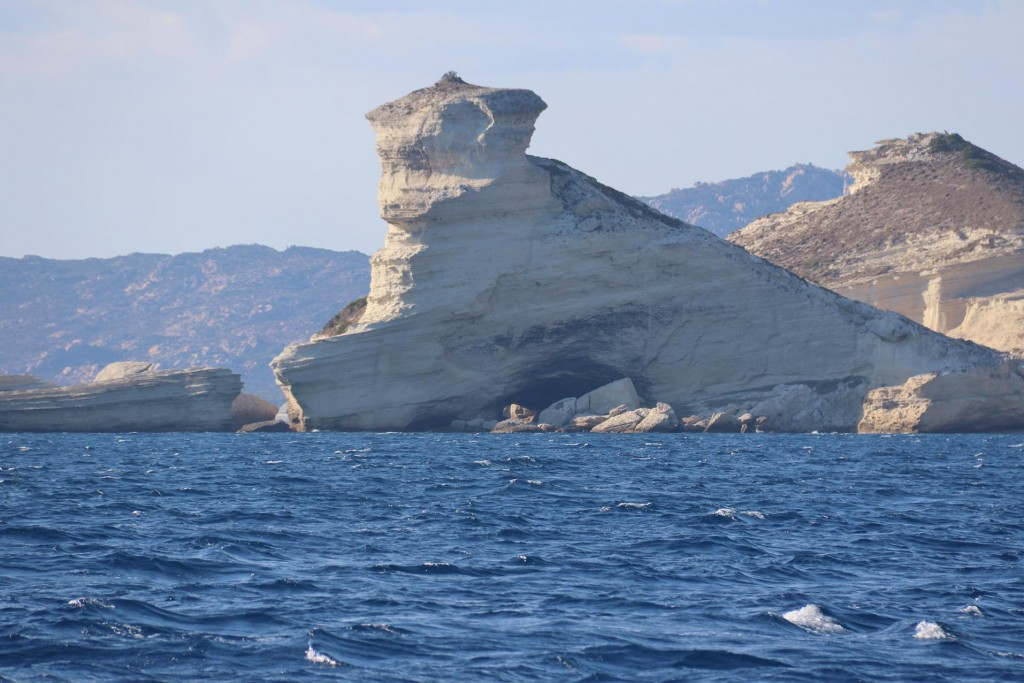 We approach the well photographed rock formation by Bonifacio with St Antoine Cave below