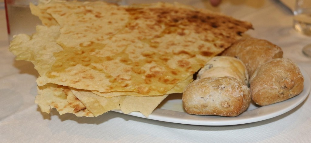 Great bread rolls and crisp pita arrive at the table