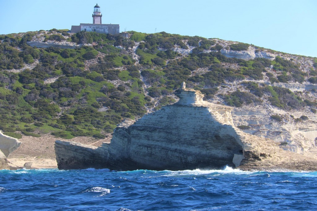 The light house on Capo Pertusatu with a rock formation in the foreground that resembles a ship !!