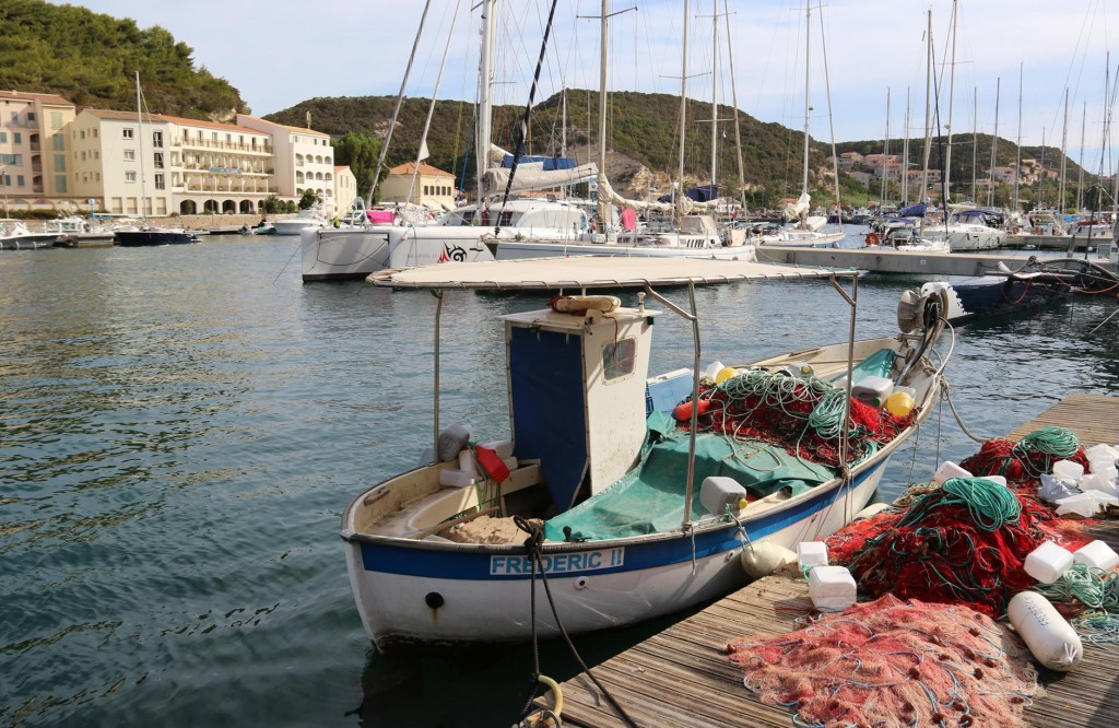 A cute little fishing boat tied up in port
