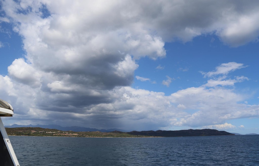 Dark clouds start to appear in the distance over mainland Corsica