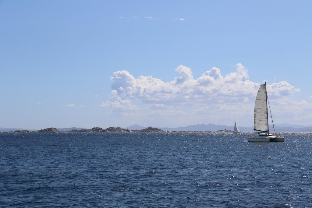 We head towards Ile Cavallo, a small island nearby with the La Maddalena Archipelago in the distance