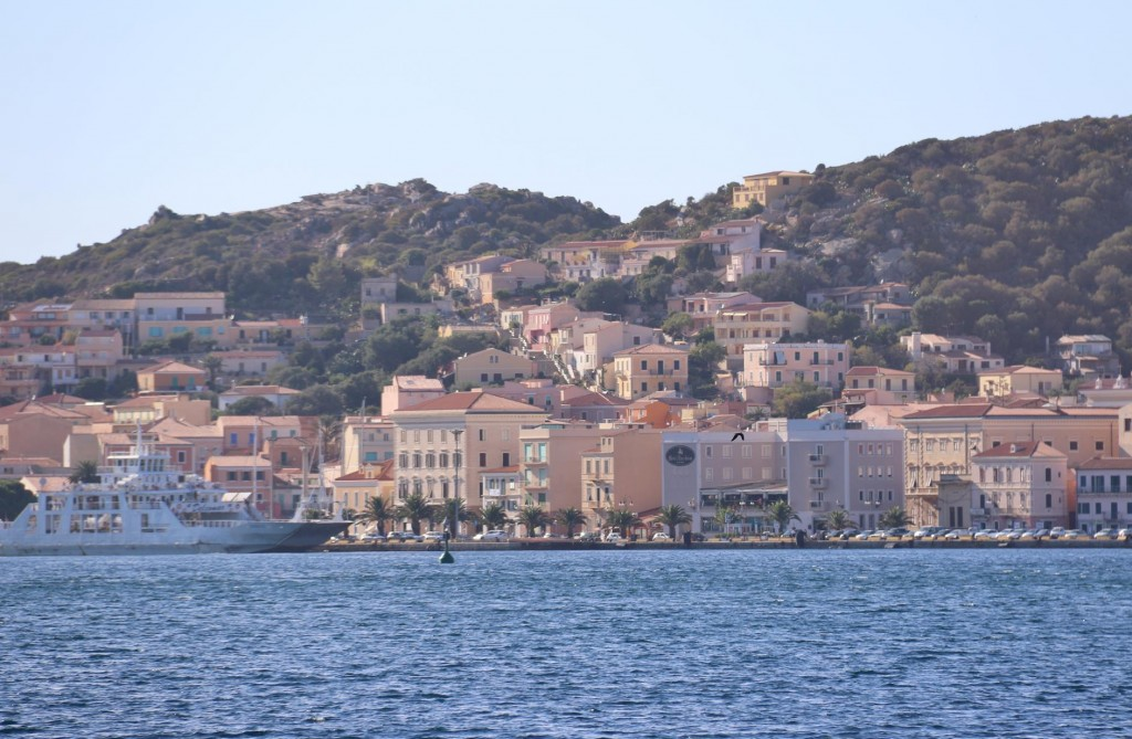 The pastel coloured houses of the port of La Maddalena where hope to get a berth for the night
