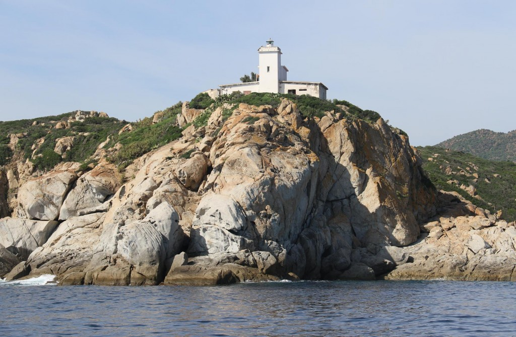 We pass the lighthouse at Capo Ferrato