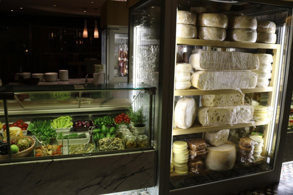 The well stocked cheese cabinet in the restaurant