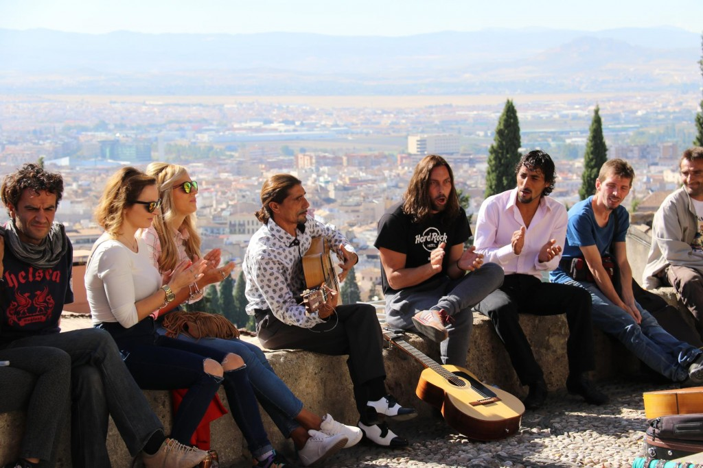 At the Mirador de San Nicholas which is the best viewing spot for The Alhambra, young musicians entertain the crowds