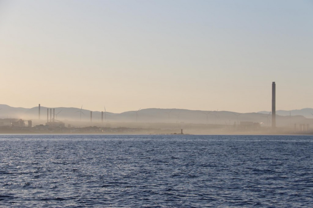 Early morning haze over the power plant on the Sardinian coast nearby