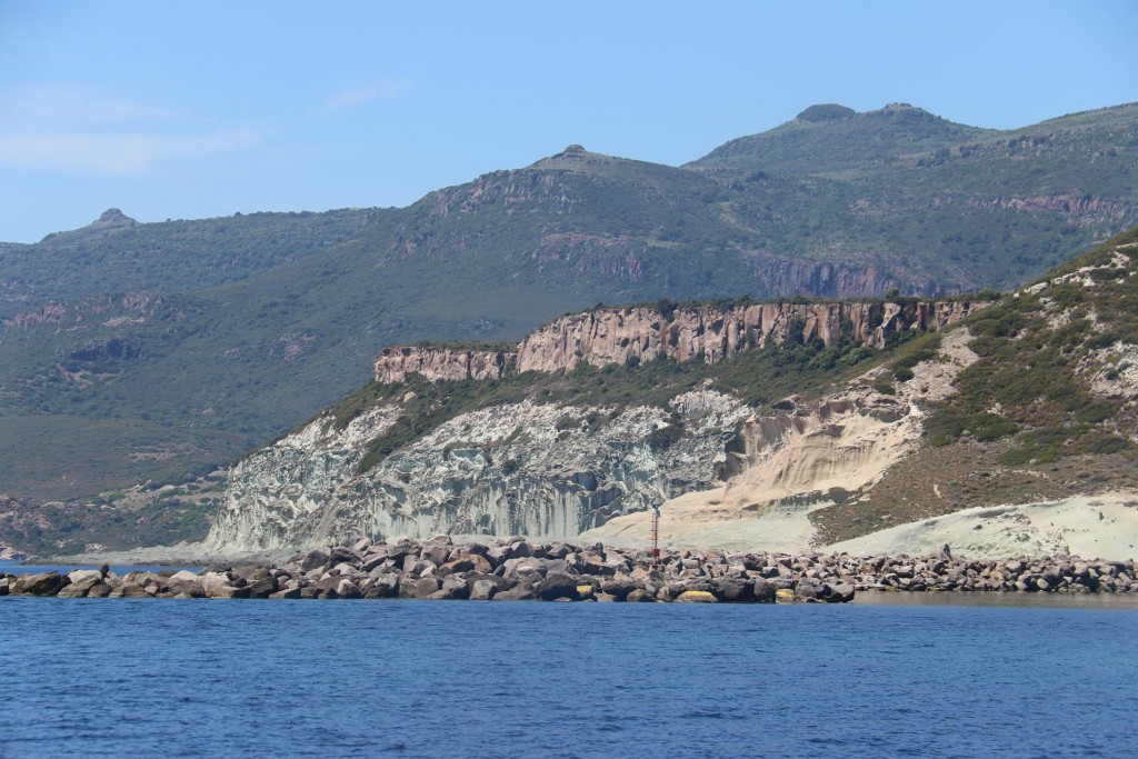 We continue north around the breakwater by Isola Rossa