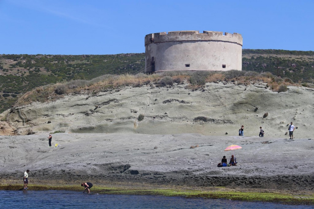 Isola Rossa which is attached to the point, is a popular spot for fishing and enjoying the sun