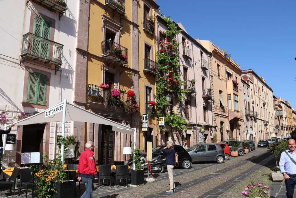 The main street with it's delightful multi storied houses with balconies and colourful floral displays