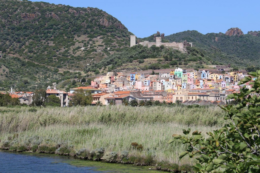 I stop on the way to get a few more shots of the colourful houses of Bosa and the Castle looming above
