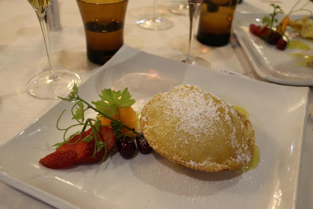 The traditional Sardinian dessert Seadas which is a fritter filled with cheese, deepfried and served with honey