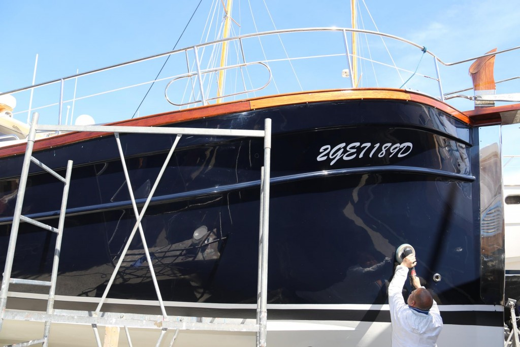 He has been painting, antifouling, cleaning and polishing the exterior of the boat