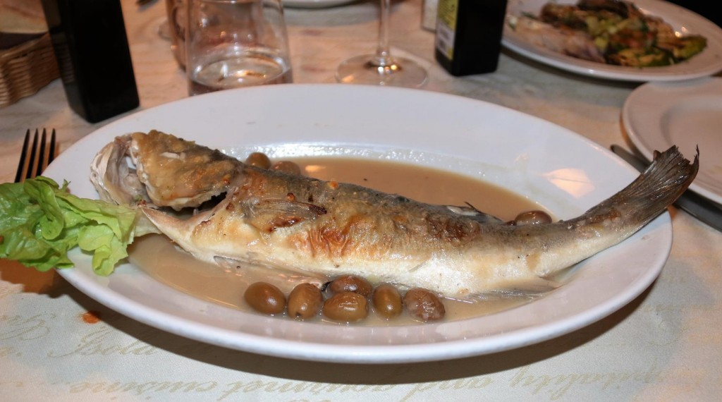 The seabass was perfectly cooked in the oven with wine and olives
