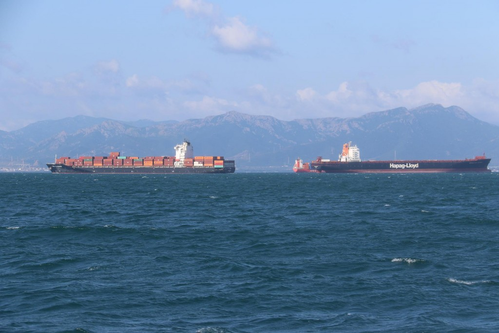 As we approach Cagliari several cargo ships lie in the bay