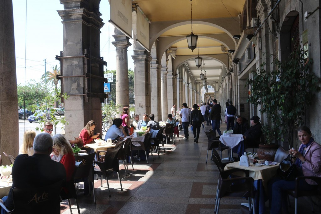 Cafes and bars undercover along via Roma are very popular day and night