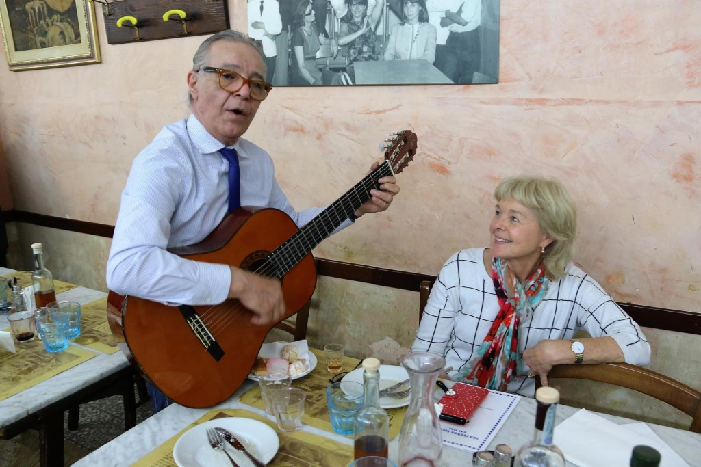 Mine host once again brings out his guitar and serenades the customers with old 60's favourites