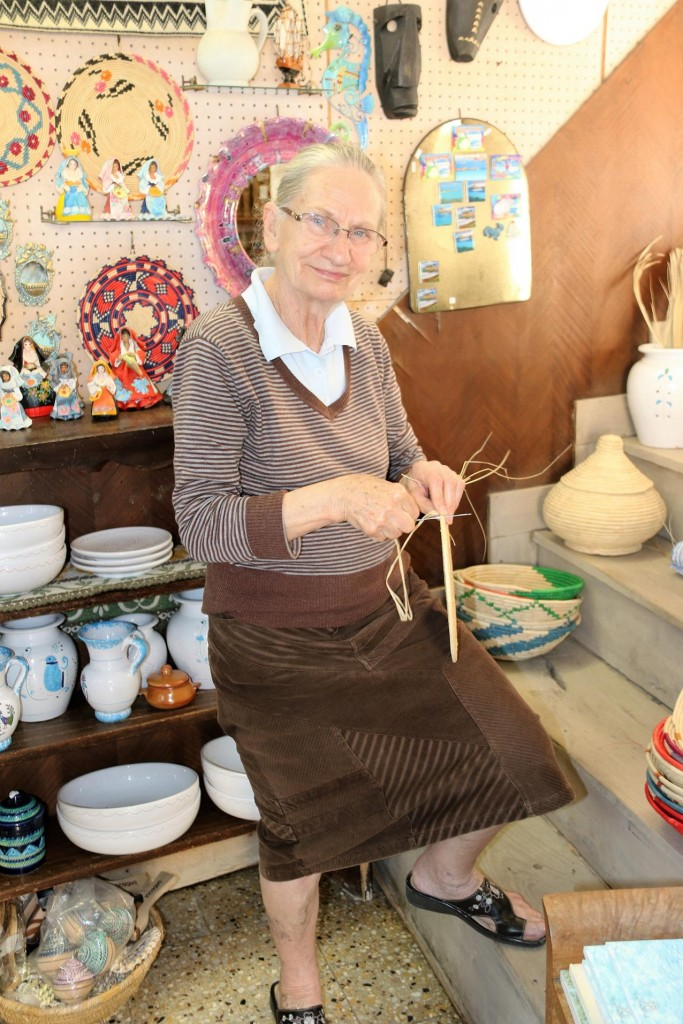 Maria, who has a shop in the castle walls, showing me her expert skills in basket weaving