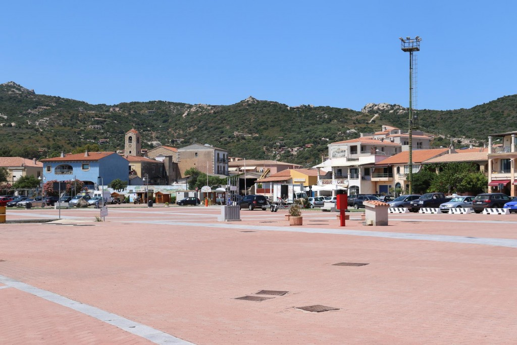 There is a large open square by the port in Cannigione