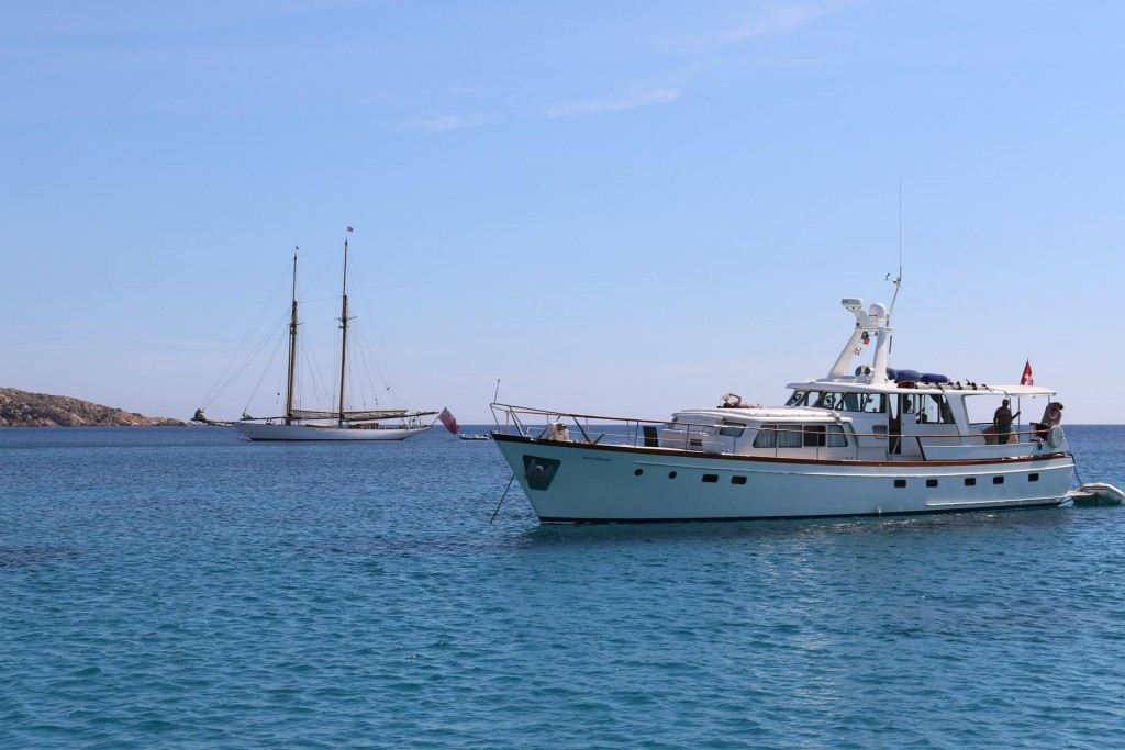Another fine looking vessel is also moored in Cala Portese