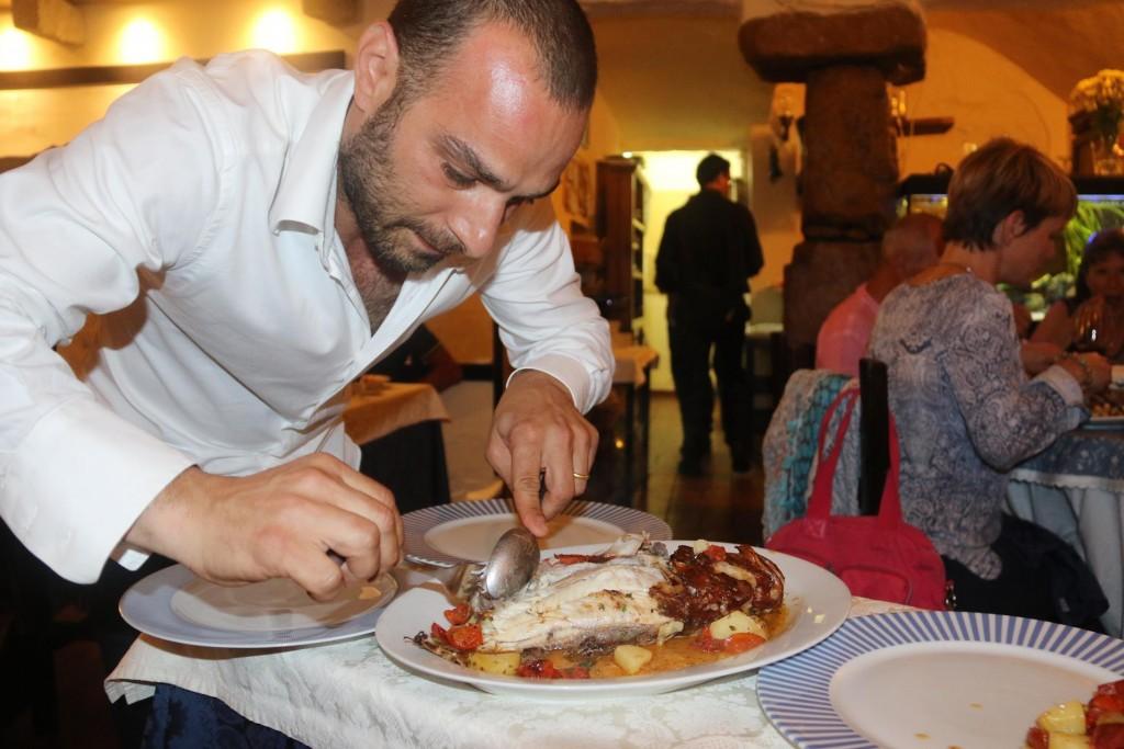 I order the pesce al forno con pomodorini