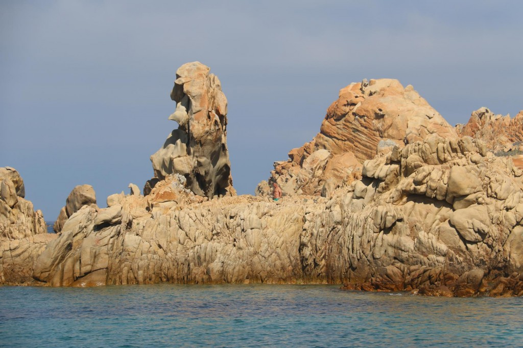 John swims to a small rocky cove nearby and manages to go ashore