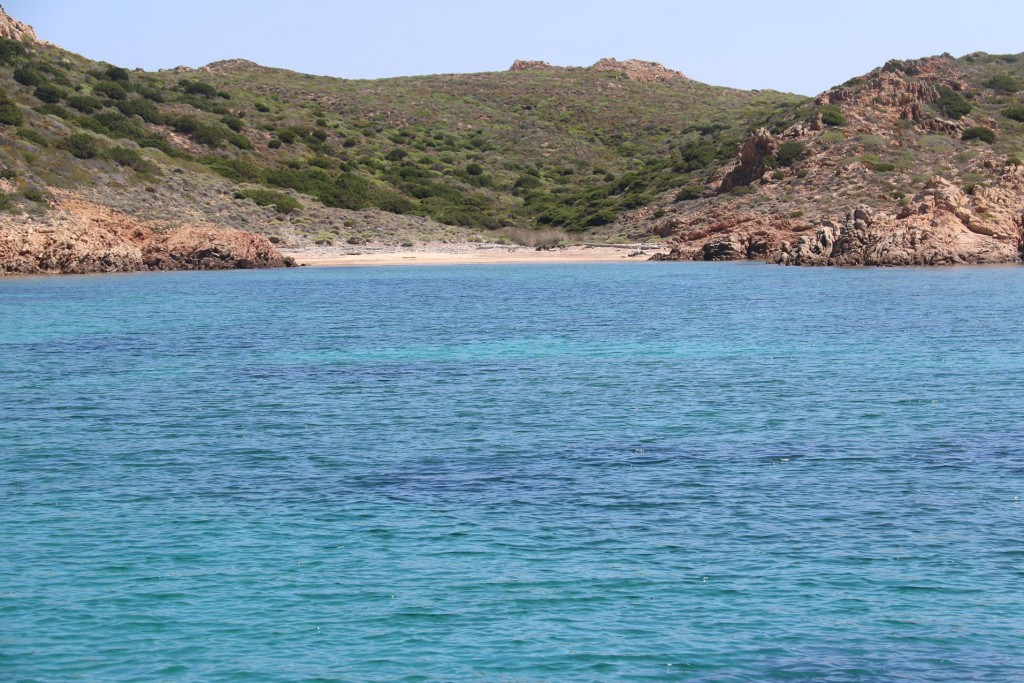 A small white sandy beach in the long narrow bay gives us a welcome spot to swim to this morning