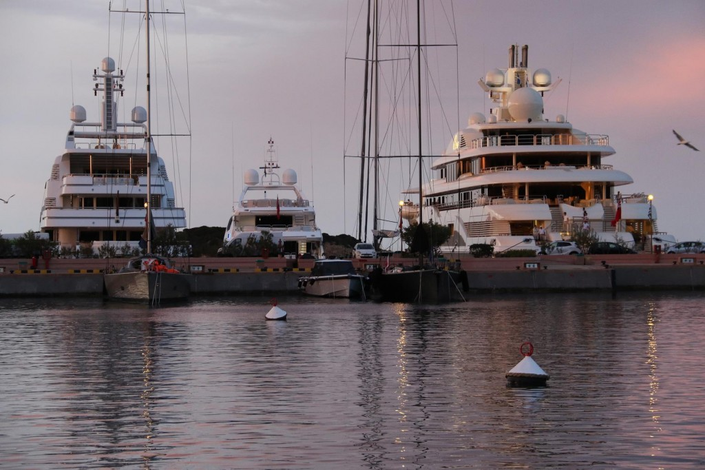 Another huge super motor yacht arrives in the port during the day