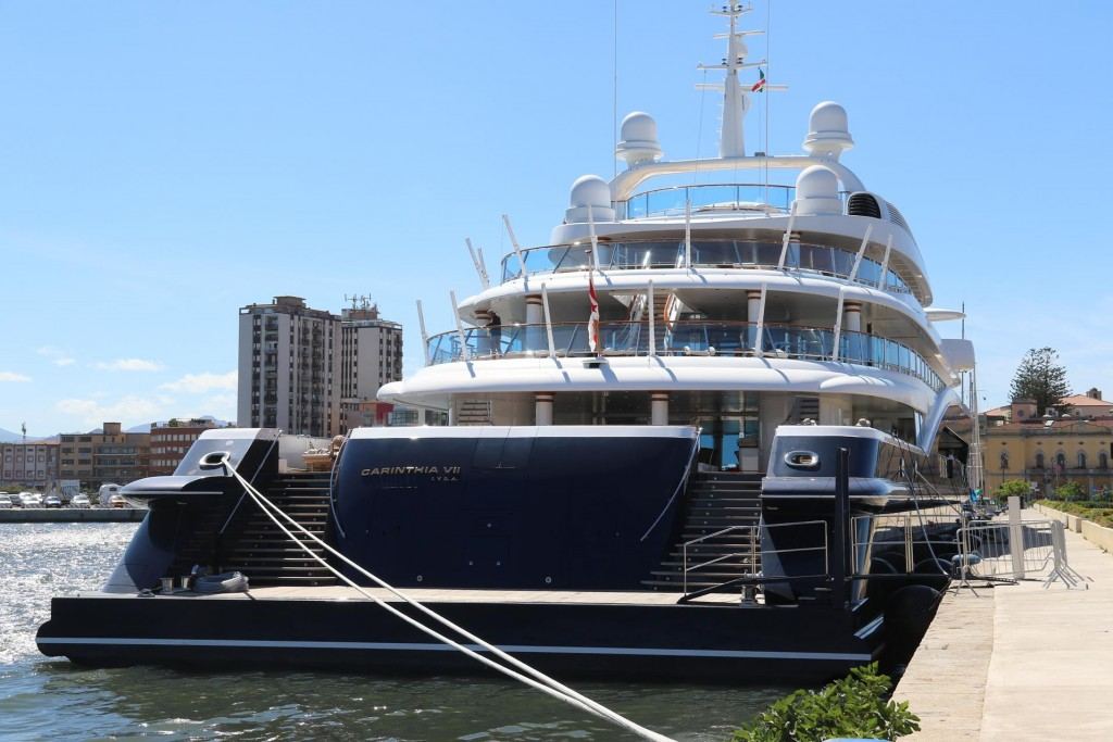 We stop by the port and a very large super motor yacht fills the quay
