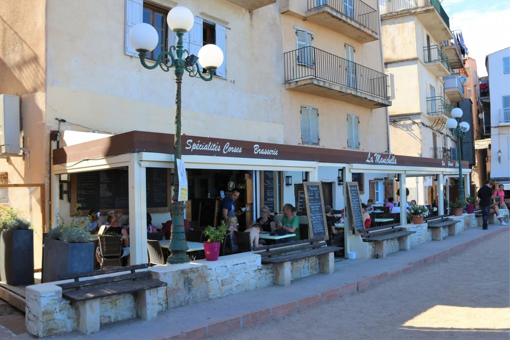 A delightful restaurant with a boules on the side