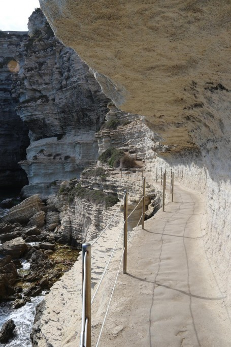 Once at the bottom we follow the carved path along the face of the cliffs to a grotto