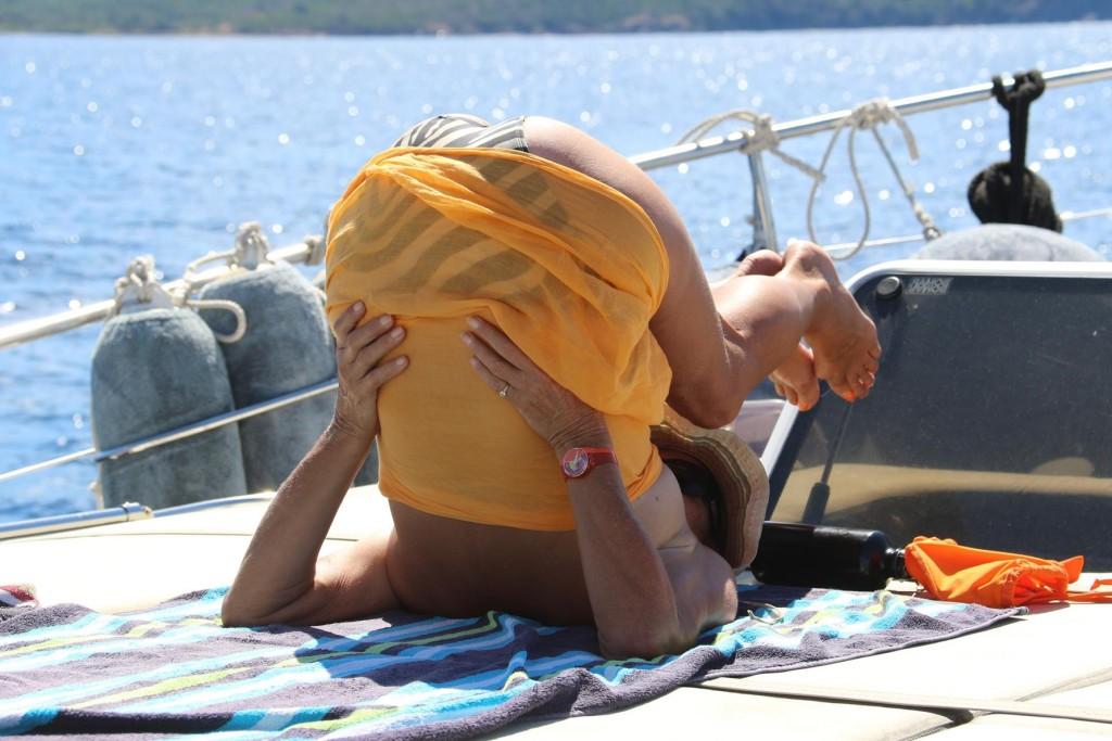 As we travel Michele limbers up with a bit of yoga on the front deck
