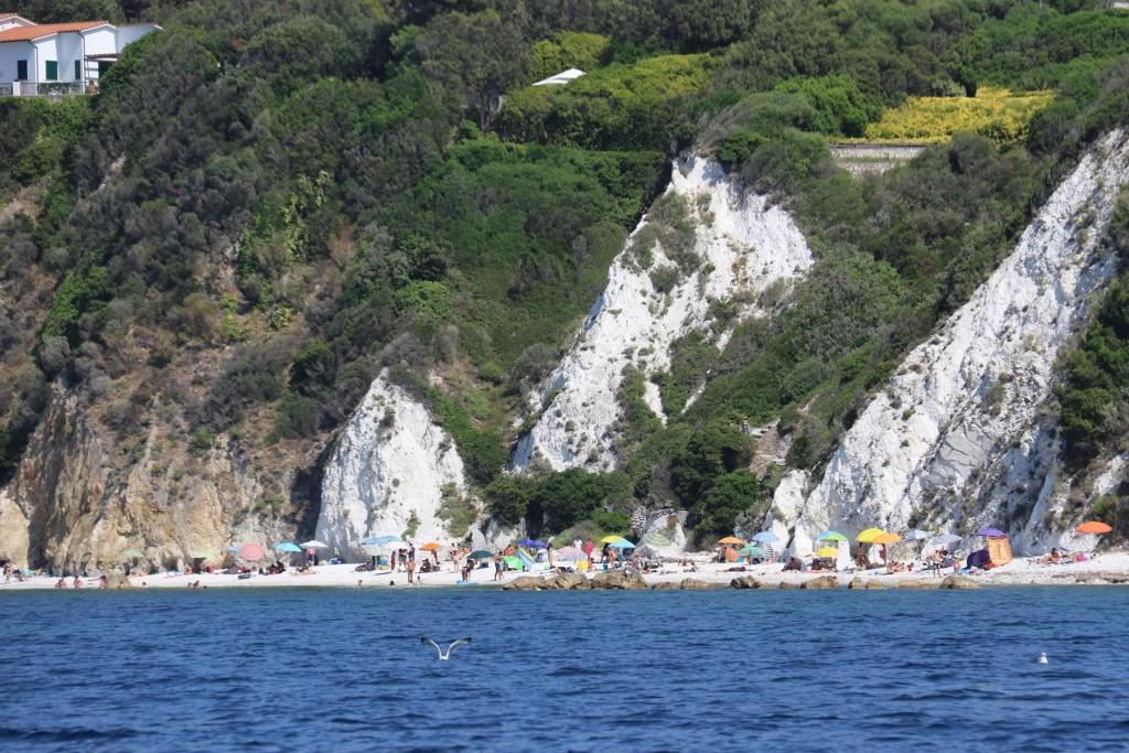 The beach goers have already claimed their umbrellas