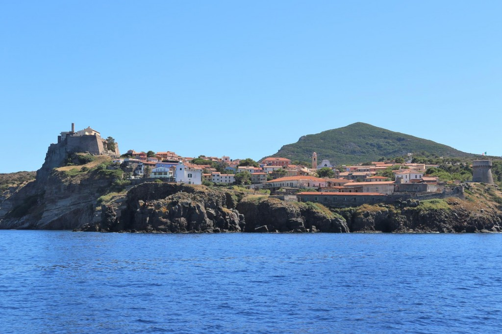 As we approach Capo Ferraione the fort, the white square lighthouse and the old tower stand out