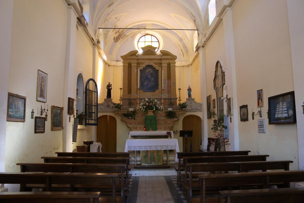 The simple interior of the Church of the Assunta