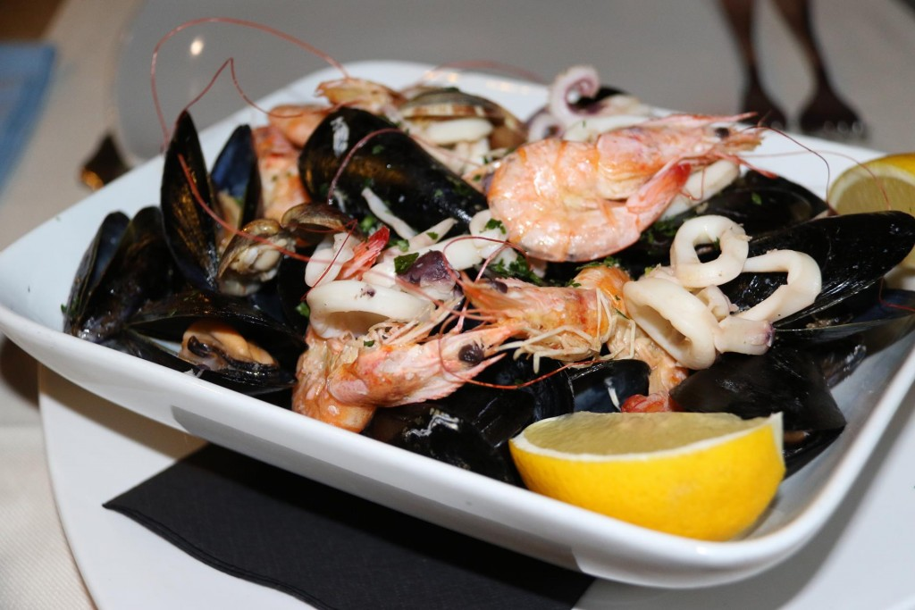 Our share entree was a combination of steamed mussels, prawns and calamari which we all delicious