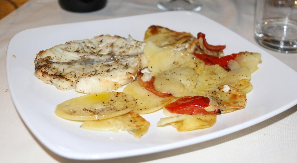 Tonight we have the swordfish cooked in the oven with potatoes and tomatoes