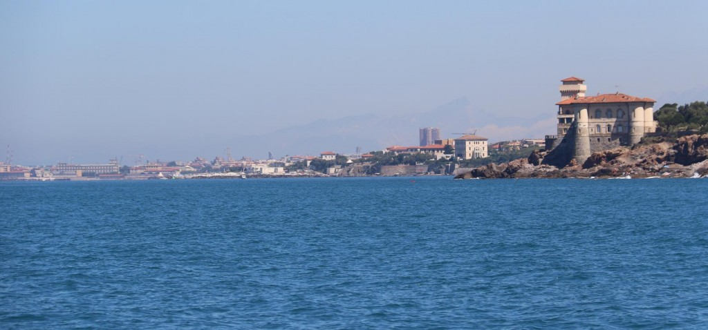 With numerous freighters  moored nearby we near the outskirts of the large industrial port of Livorno
